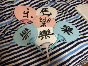 Fans featuring Japanese calligraphy