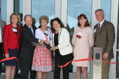 Woodbury Mayor Mary Giuliani Stephens, Fraser board members and Russell S. King, chairperson and president of the Peter J. King Family Foundation, cut a ribbon to symbolize the official opening of the Fraser Woodbury Clinic on Wednesday, June 20, in Woodbury. Hannah Black / RiverTown Multimedia