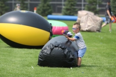 Dorian, 4, prepares to shoot at an opponent during the toy battle on Aug. 11, 2018, at East Ridge High School in Woodbury. Hannah Black / RiverTown Multimedia