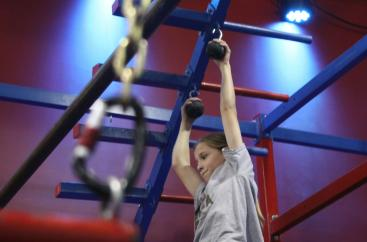 "Bella Palmer, 9, practices the ""Cannonball Climb"" on Oct. 4, 2018, at Conquer Ninja Warrior in Woodbury. Hannah Black / RiverTown Multimedia"