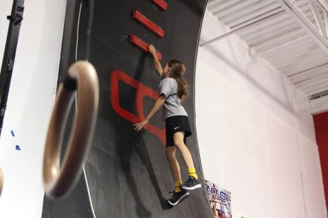 """Bella Palmer, 9, practices the """"Cannonball Climb"""" on Oct. 4, 2018, at Conquer Ninja Warrior in Woodbury. Hannah Black / RiverTown Multimedia"""