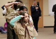 Maggie Veith (front) and other members of Troop 7071 salute the U.S. flag at the beginning of a Feb. 25 meeting at The Grove United Methodist Church in Woodbury. Hannah Black / RiverTown Multimedia