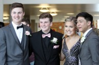 Seniors Graham Netten (left), Jack Coquyt, Julia Burns and Jaymar Basilio pose for a photo following the East Ridge High School grand march on April 27, 2019. Hannah Black / RiverTown Multimedia