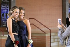 Sophomore Paige Hermann takes a photo of seniors Stephanie Barber (left) and Carissa Dagon following the East Ridge High School grand march on April 27, 2019. Hannah Black / RiverTown Multimedia