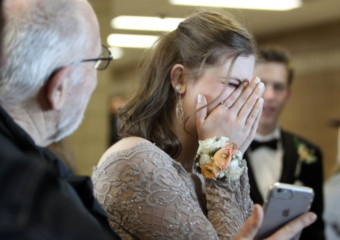Junior Emma Block laughs in reaction to a photo taken of her following the East Ridge High School grand march on April 27, 2019. Hannah Black / RiverTown Multimedia